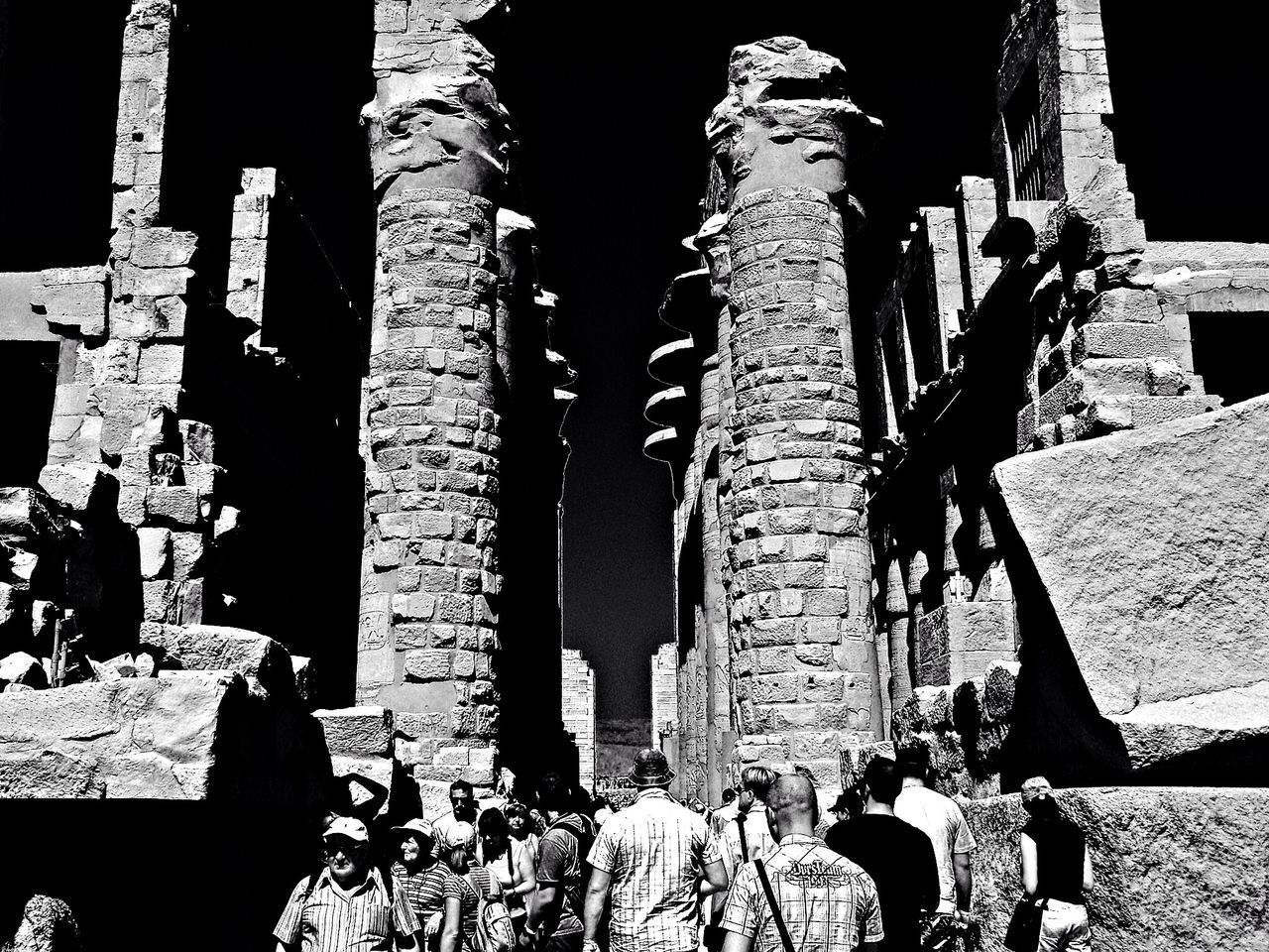 real people, large group of people, history, men, old ruin, built structure, ancient, leisure activity, women, architecture, religion, travel destinations, spirituality, tourism, ancient civilization, outdoors, place of worship, lifestyles, travel, day, building exterior, architectural column, sky, adult, people