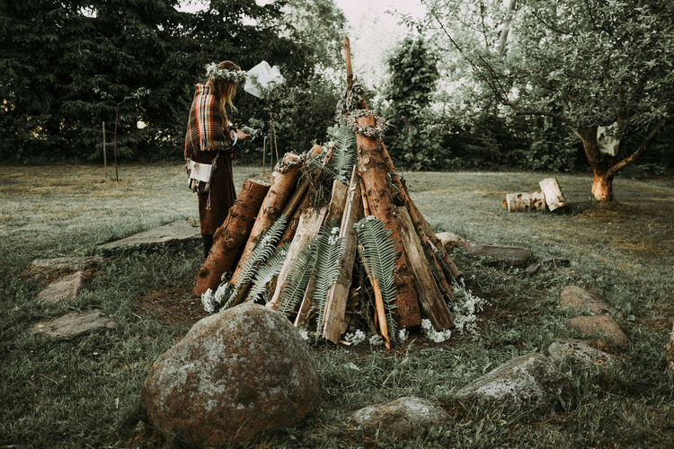 Ligo Festival The Photojournalist - 2018 EyeEm Awards Day Deforestation Effort Field Firewood Forest Full Length Land Large Group Of Objects Log Men Nature One Person Outdoors Plant Real People Standing Timber Tree Wood Wood - Material