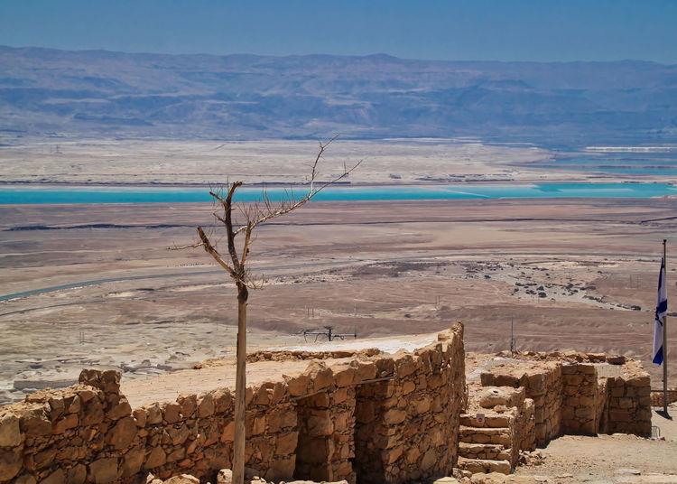 View of the Dead Sea as seen from atop the ruins of Masada. Abandoned Places Dead Sea View Dead Tree Desert Doors Jordan Middle East Masada. Israel Ruins Stairs Steps Ancient Civilization Beauty In Nature Day Israel Mountain Nature No People Outdoors Sand Scenics Sea Sky Stone Material Tranquility Water