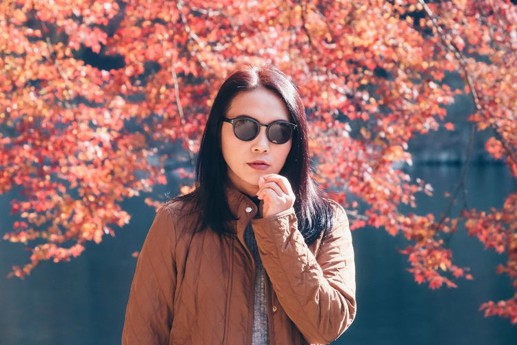 Fashion Stories Autumn Only Women Leaf Beauty One Person One Woman Only Beauty In Nature Red Tree Women Beautiful Woman One Young Woman Only Real People Outdoors Nature Eyeglasses  Day