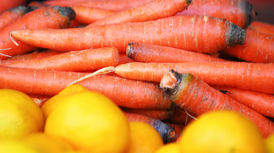 carrot and lemons at a market Vitamin C Carrot Lemon Vitamin B Vitamin B12 Farmer's Market Food And Drink Food Healthy Eating Freshness Vegetable Root Vegetable Wellbeing Full Frame Large Group Of Objects Close-up Backgrounds Orange Color Abundance No People Market Still Life Retail  Heap Organic Ripe