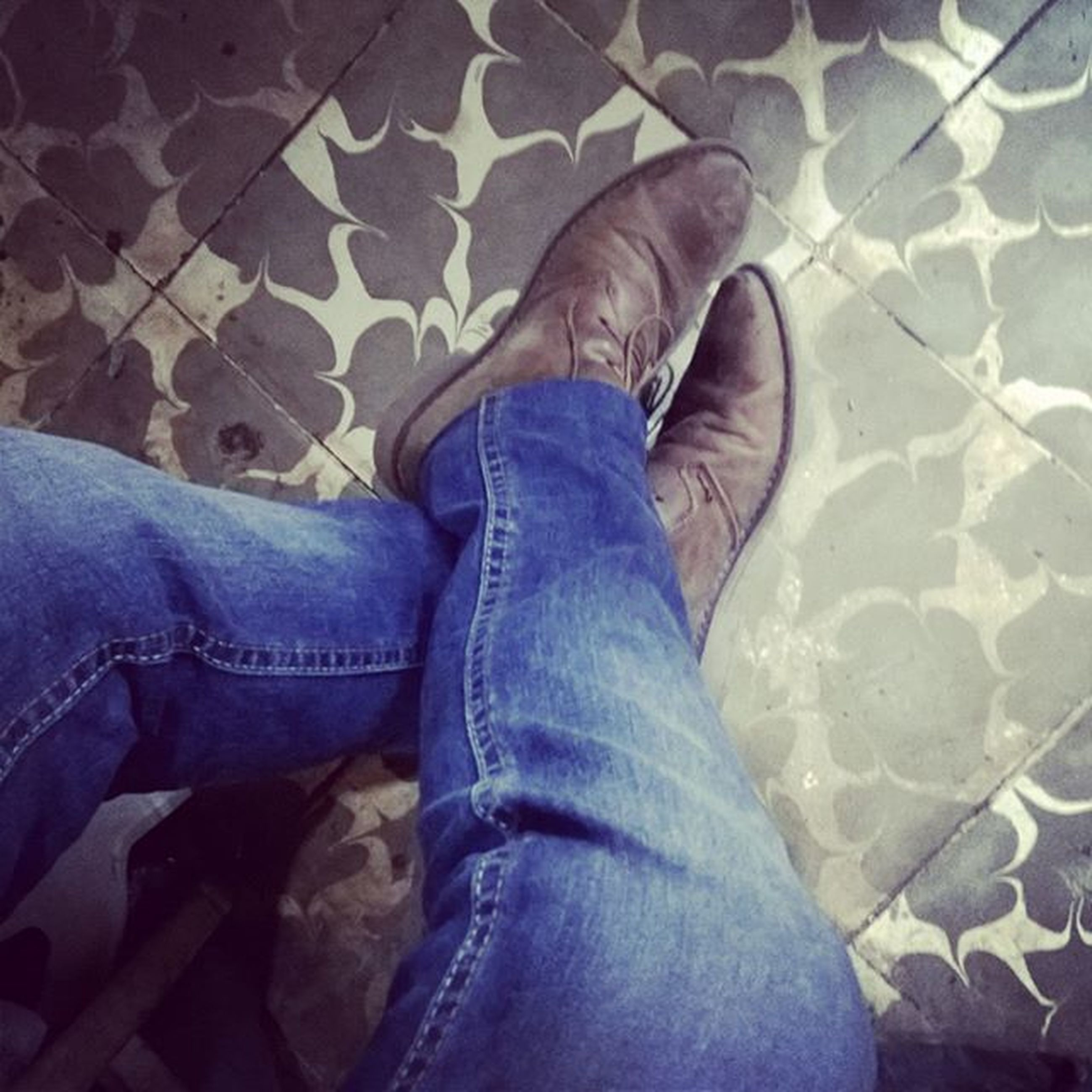 low section, person, shoe, jeans, personal perspective, high angle view, lifestyles, relaxation, men, casual clothing, leisure activity, indoors, standing, human foot, sitting, resting, footwear