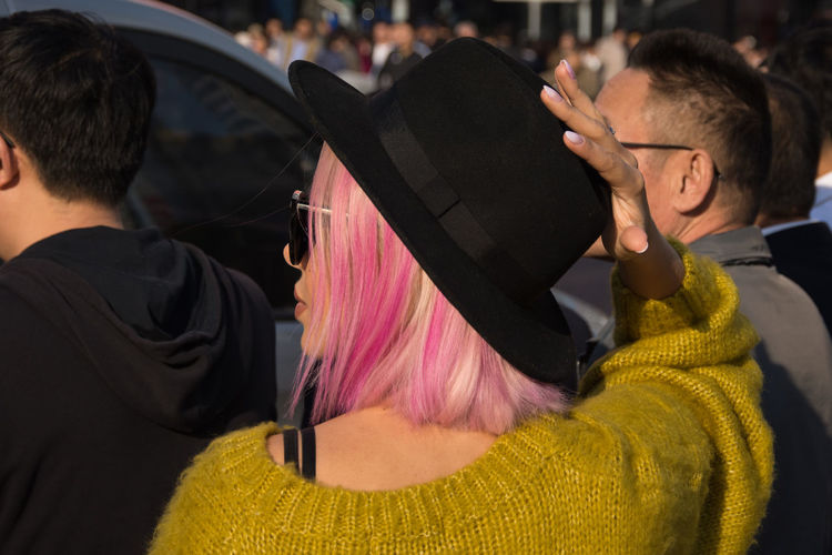 A splash of colour in the city Rear View Focus On Foreground Pink Hair Colourful People Real People Street Photography Outdoors Hairstyle Sunlight Contrast Traveling Travel Photography Hat Nails Triasia Trip Sunglasses Chinese Girl Hands Fingers Capture Tomorrow Streetwise Photography