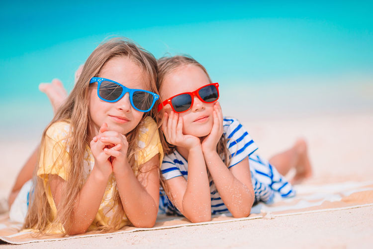 Low angle view of women wearing sunglasses on beach