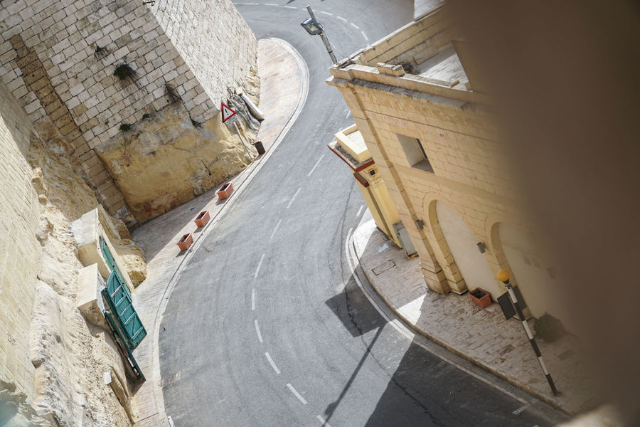 Mediterranean, Middle East type city - winding road / street between high buildings Arch Architecture Areal Bricks Buildings Capital City Corner From Above  Gates Grand Harbour High Angle View High Wall House Limestone Malta Marina Mediterranean  Middle East Sand Street Town Valletta Wall Winding Road