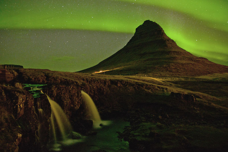 Beauty In Nature Tranquil Scene Sky Scenics - Nature Night Mountain Tranquility Nature Water No People Star - Space Environment Long Exposure Landscape Astronomy Idyllic Non-urban Scene Mountain Peak Space Land Aurora Borealis Iceland Northern Lights Waterfall Magical