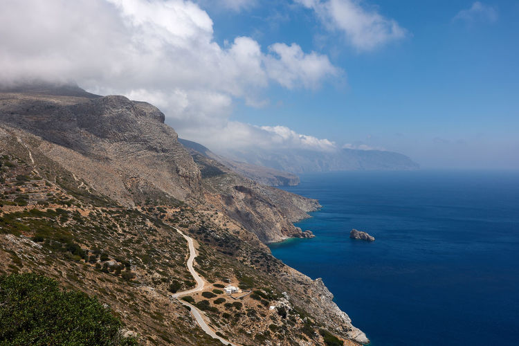 Amorgos Coast Bay Beauty In Nature Cloud - Sky Day Horizon Over Water Land Mode Of Transportation Mountain Nature Nautical Vessel No People Non-urban Scene Outdoors Rock Rocky Coastline Sailboat Scenics - Nature Sea Sky Tranquil Scene Tranquility Transportation Travel Water