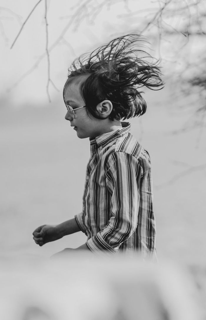 Side view of boy with tousled hair