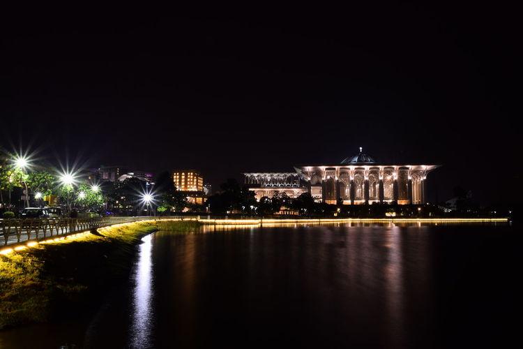 Tuanku Mizan Sultan Zainal Abidin mosque at night view from lake side. Mosque Night Illumination Lights Landscape