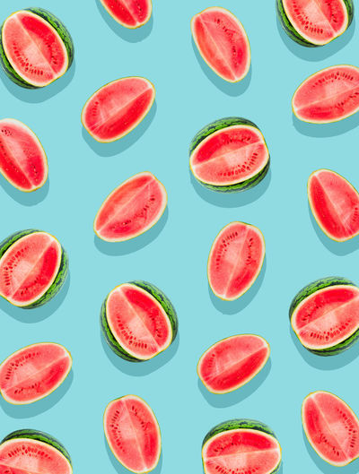 Watermelon pattern. Slices of watermelon on a plain surface painted in bright blue Food Healthy Eating Fruit SLICE Red No People Watermelon Freshness Ripe Backgrounds Eating Healthy Fresh Freshness Background Texture Pattern Juicy Flat Lay Natural Melon Organic Slices Sweet Vegetarian
