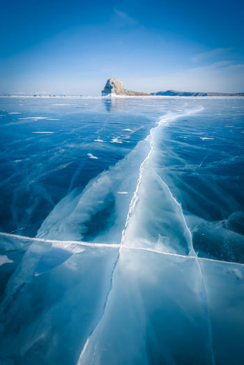 Natural breaking ice in frozen water at Lake Baikal, Siberia, Russia. Water Sea Scenics - Nature Beauty In Nature Blue Nature Day Ice No People Cold Temperature Reflection Tranquility Sunlight Winter Outdoors Swimming Pool Irkutsk Baikal Lake Russia Frozen Sky Waterfront Idyllic Surface Level