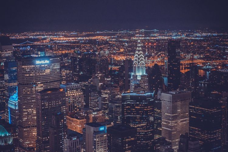 Aerial view of chrysler building amidst cityscape at night