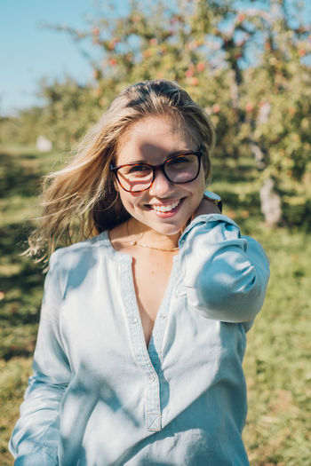 Beautiful Woman Blond Hair Casual Clothing Cheerful Day Eyeglasses  Focus On Foreground Happiness Leisure Activity Lifestyles Looking At Camera Nature One Person Outdoors People Portrait Real People Smiling Young Adult Young Women