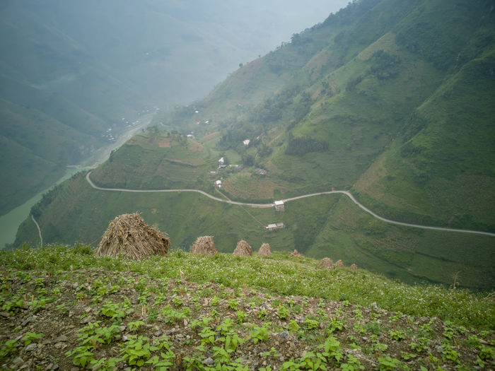Stunning view of the Meo Vac landscape surrounded by mountains from the Ma Pi Leng pass in northern Vietnam. Agriculture Beauty In Nature Day Environment Field Green Color Idyllic Land Landscape Mountain Nature No People Non-urban Scene Outdoors Plant Road Rural Scene Scenics - Nature Tranquil Scene Tranquility