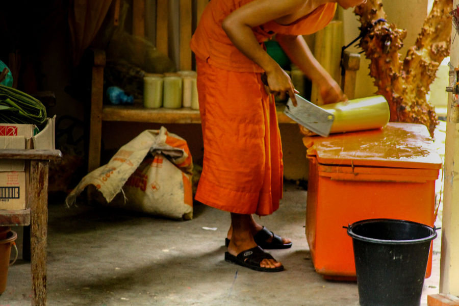 EyeEm Selects Neon Life Buddhist Monk Buddhist Monk Cooking Saffron Robe Adult One Person Occupation Working Religion Religion And Beliefs Life Of A Buddhist Monk Cambodia Lifestyle Eyeem Philippines People