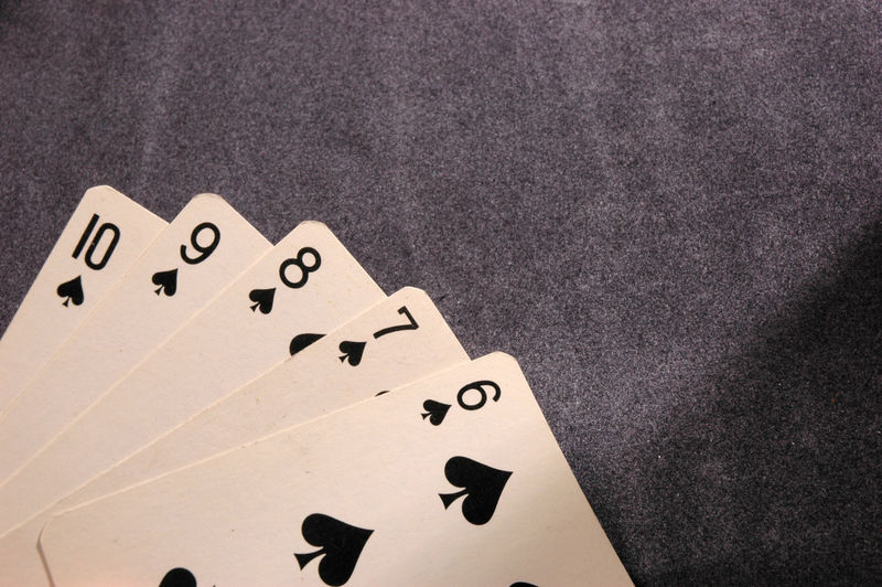 Arts Culture And Entertainment Black Color Cards Close-up Copy Space Gambling High Angle View In A Row Indoors  Leisure Activity Leisure Games Luck No People Number Opportunity Paper Playing Relaxation Still Life Table