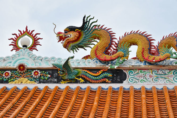 Low Angle View Of Dragon Statue At Temple