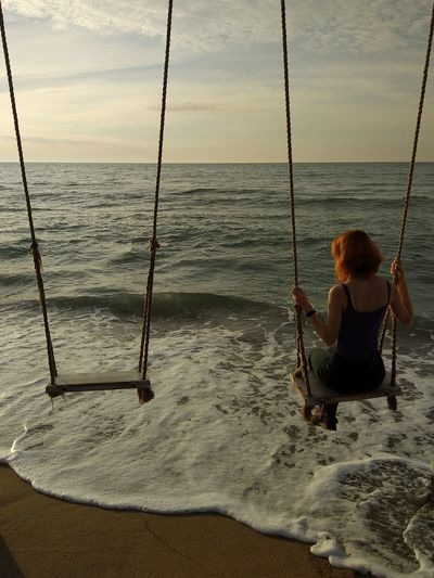 Water Sea Beach Sitting Sand Full Length Childhood Sunset Women Young Women Coastline Coast Sandy Beach Bay Sun Lounger Horizon Over Water Calm Wave Tranquil Scene Rope Swing