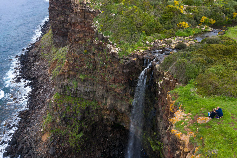 Scenic view of waterfall on rocks