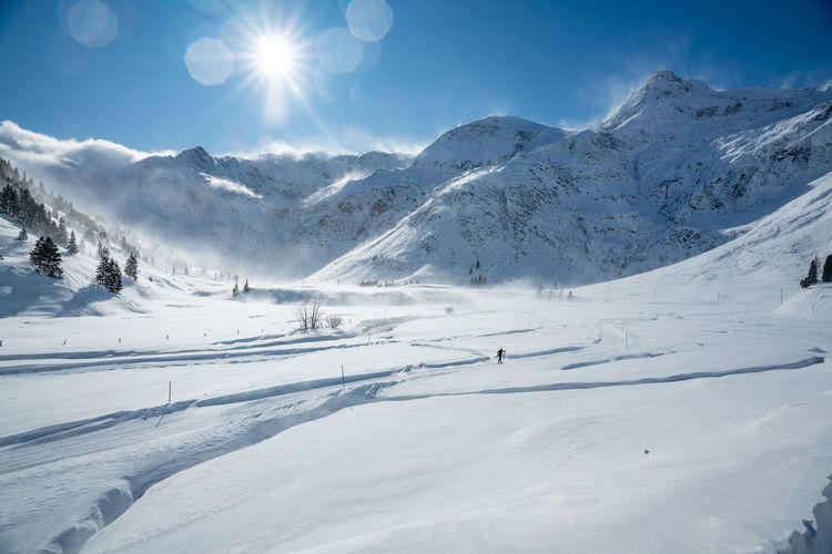 Cross country skier on track in winter wonderland in sportgastein ski resort, gastein, austria
