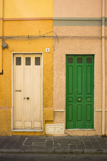 Sardinian Colors. FILIPPI GIULIA PHOTOGRAPHY. All rights reserved. Architecture Colors Couple Entrance Holiday Wall Art Building Building Exterior Built Structure Closed Day Door House Island Italy Light And Shadow Outdoors People Photographer Photography Photooftheday Picoftheday Sardegna Summer