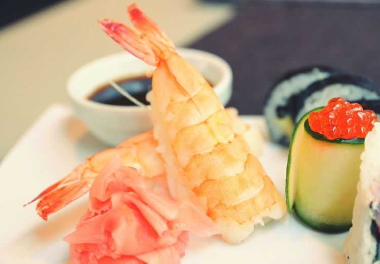 Fresh shrimps and sushi served with savory sauce