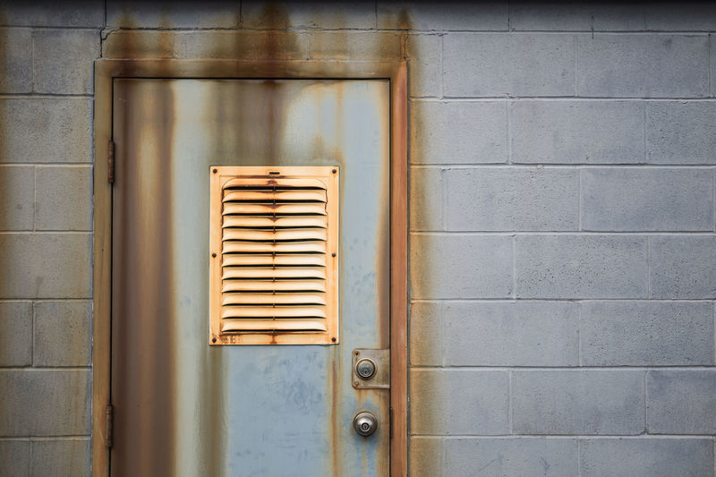 Close-Up Of Closed Door With Air Duct