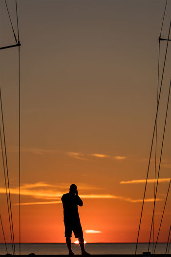 Sunset photographer Sunset Silhouette Scenics Sunset Silhouette Scenics Sea Men Horizon Over Water Tranquility Sky Water Tranquil Scene Idyllic Dusk Standing Beauty In Nature Orange Color Atmosphere Vacations Nature Cloud - Sky Atmospheric Mood First Eyeem Photo