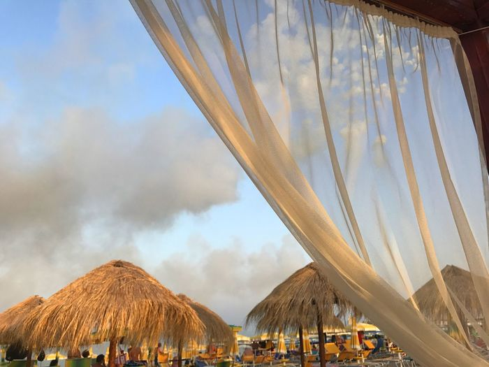 EyeEm Selects Thatched Roof Vacations Outdoors Day Sky Shelter Beauty In Nature Nature Beach No People