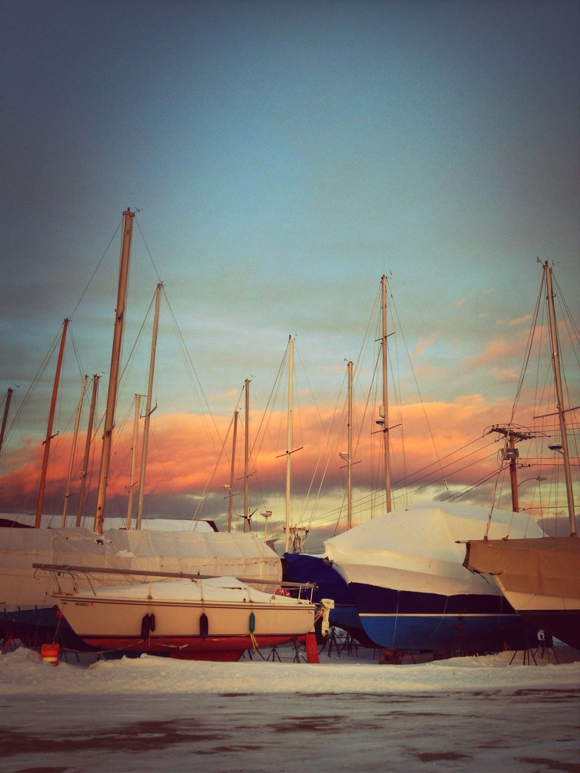 nautical vessel, transportation, moored, boat, mode of transport, sunset, mast, harbor, water, sea, sky, sailboat, nature, tranquility, no people, tranquil scene, orange color, outdoors, commercial dock, beauty in nature