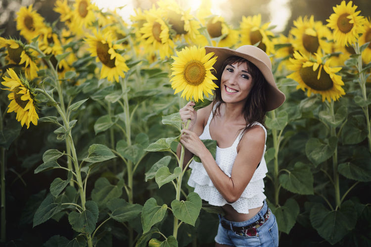 Freedom Fun Holidays Lifestyle Sunflower Vitality Wellness Woman Beautiful Woman Beauty Caucasian Enjoy Flower Girl Happiness Landscape Looking At Camera One Person Outdoors Portrait Smile Smiling Summer Women Young Women