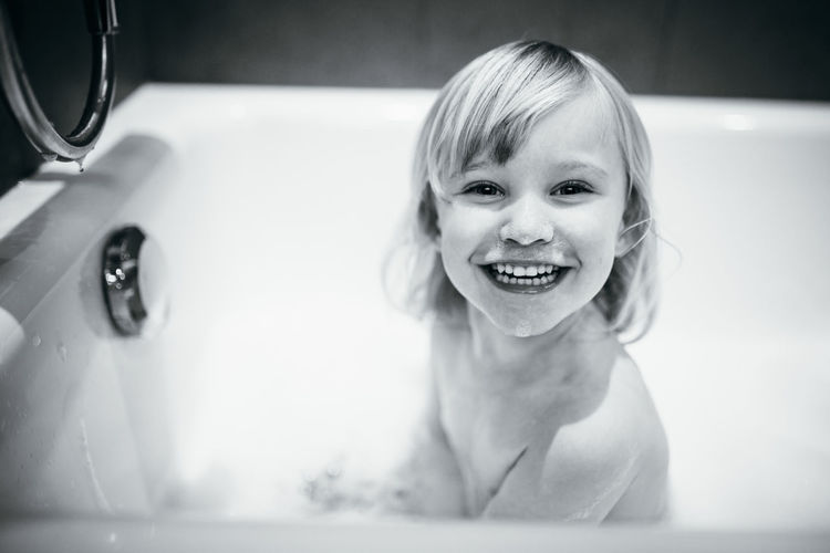 Happy bath The Portraitist - 2018 EyeEm Awards Bathroom Bathtub Child Childhood Cleaning Domestic Bathroom Domestic Room Happiness Headshot Home Hygiene Indoors  Innocence Looking At Camera Offspring One Person Portrait Smiling Taking A Bath