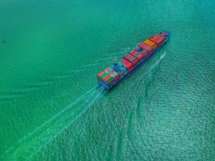 High Angle View Of Container Ship Sailing In Sea