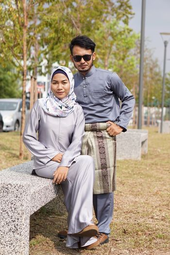 EyeEm Selects Two People Togetherness Young Adult Young Men Traditional Clothing Full Length Fashion Baju Kurung Modern Outdoors Men Lifestyles Adult Looking At Camera Portrait Adults Only Young Couple Happiness Day Baju Melayu Samping in Malaysia