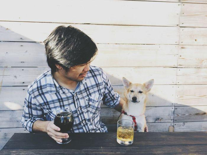 Man With Dog Having Drinks