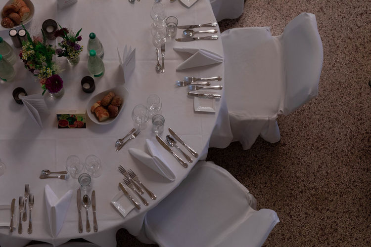 party in white Absence Arrangement Crockery Eating Utensil Food Food And Drink Fork Glass High Angle View Household Equipment Indoors  Kitchen Utensil Luxury Napkin No People Place Setting Plate Setting Still Life Table Table Knife Tablecloth White Color