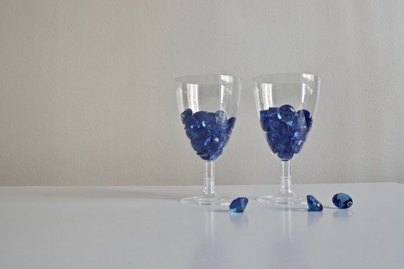 Celebration Drinking Glass Party - Social Event Wineglass Indoors  Shot Glass Gray Background No People Blue Hobby Accesories Diamonds Diamond Life Beautiful Diamonds Rich Life Decoration Luxury Design Crystal Red Diamond Wine Glass Indoors  Diamond Celebration Blue Diamonds