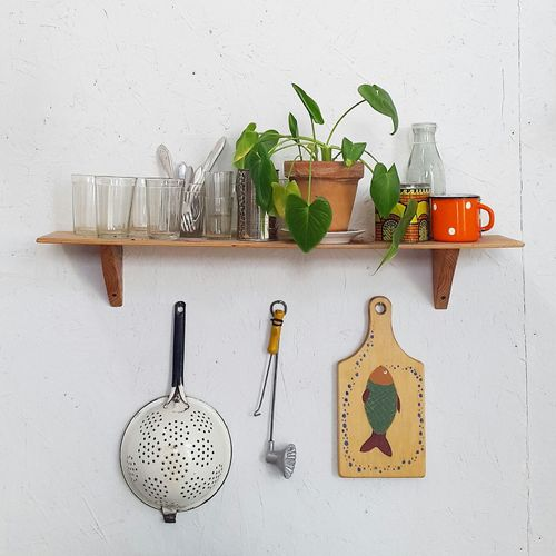 Kitchen utensil mounted on wall