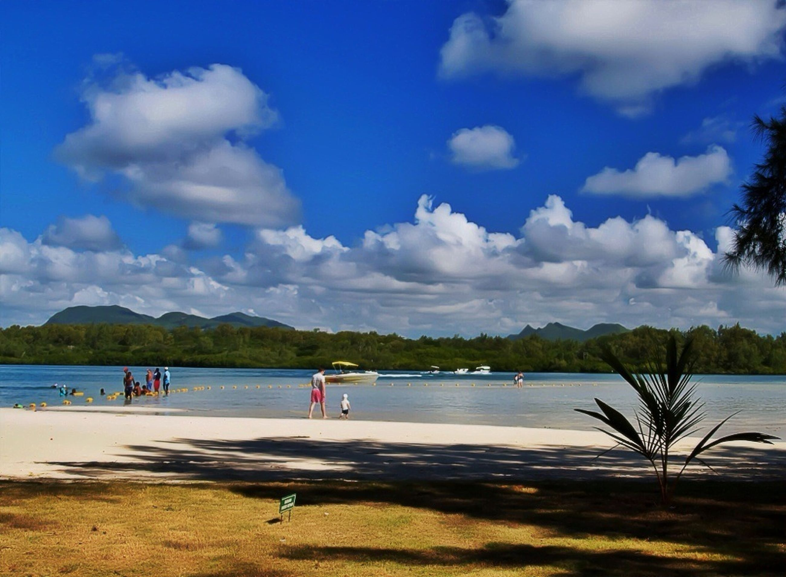 water, sky, beach, tranquil scene, tranquility, scenics, sea, shore, sand, cloud - sky, beauty in nature, cloud, nature, mountain, blue, leisure activity, tree, vacations, lifestyles