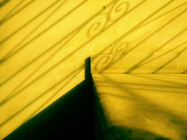 Learn & Shoot: Balancing Elements the Simplicity in the beauty of yellow. Sunset Light Yellow Light And Shadow Ironwork  Shadows Proportion Marbel Wall Pastel Power Pastel Yellow Pastels