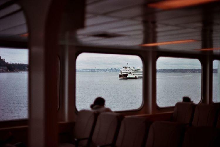 Cruise sailing in sea seen through window