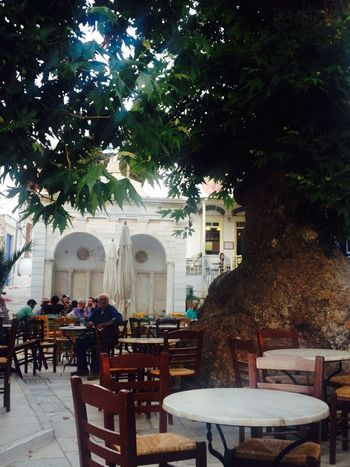 Here Belongs To Me Tree Square Coffee Time Table Chairs Marble Monument Cyclades Tinos Greece Island Pyrgos Village People Enjoying Life Neighborhood Map Your Ticket To Europe