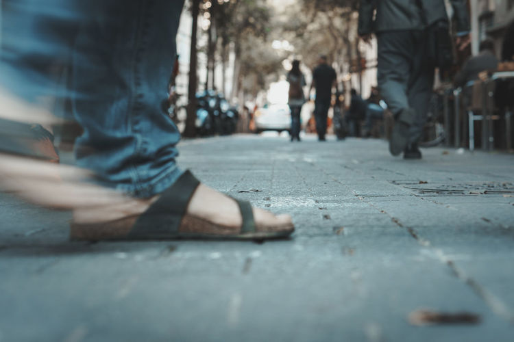 Urban Lifestyle Body Part City Day Footpath Human Body Part Human Foot Human Leg Human Limb Incidental People Leisure Activity Lifestyles Low Section Outdoors People Real Life Real People Road Selective Focus Social Issues Street Streetphotography Surface Level Urban Walking Legs Crossed At Ankle Canvas Shoe Personal Perspective Feet Human Toe Flat Shoe The Street Photographer - 2018 EyeEm Awards