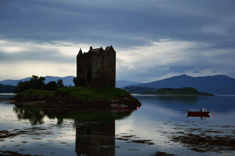 Architecture Boat Built Structure Castle Castle Stalker Cultures History Island Loch  Outdoors Reflections Reflections On The Water Scotland Sea Sea And Loch Skies Skies And Clouds Sky Sunset Light Tranquil Scene Tranquility Travel Destinations Water