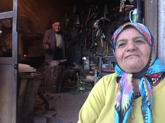 Old couple in their artisan lab Hospitality Generosita Semplicità Simple Life Artisian Artigiano Fucina Old Man Anziano Anziana Laboratorio Antico Travel Iran Iran Travel Ferro Iron Couple Happy Couple Village Life Kind Man Happiness Emotion Real People Portrait Lifestyles Looking At Camera Senior Adult Smiling