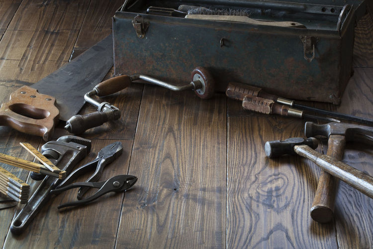 Antique tools and toolbox on dark wood surface Metal Wood - Material No People Work Tool Hand Tool Equipment Antique Old Vintage Dark Hammer Pliers Drill Brace Screwdriver Wrench  Toolbox Grunge Saw Measuring Tool Photography Ball Peen Board Brush Steel