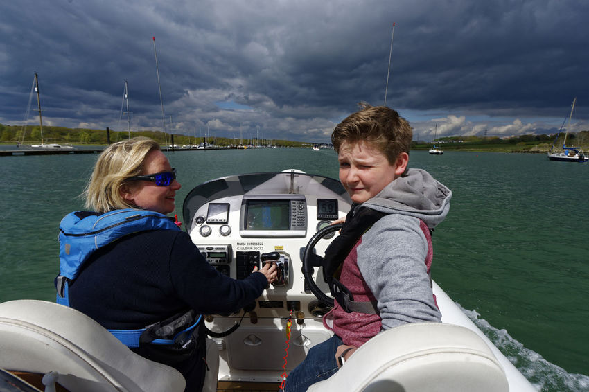 Heading up River - a storm approaches Boating Child Driving Family Fun Trip Green Waters Rib River Storm Clouds Gathering