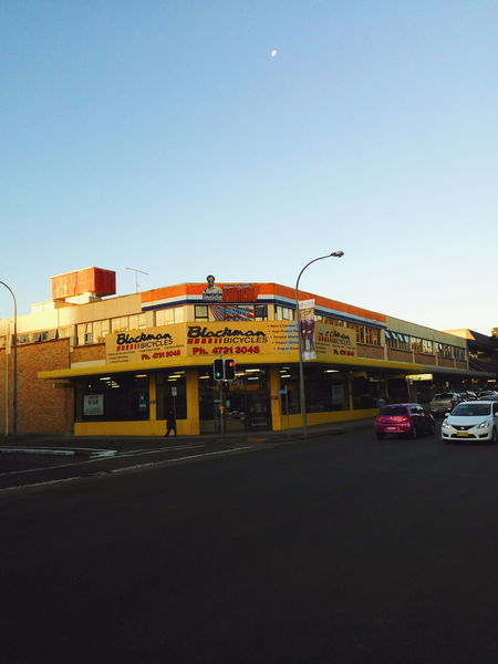 Blackman Bicycles. Penrith, Sydney, Australia. Street Streetphotography Bicycle Shop Penrith Australia Sydney Moon Traffic Cars Yellow Building Building Exterior Architecturelovers Funky