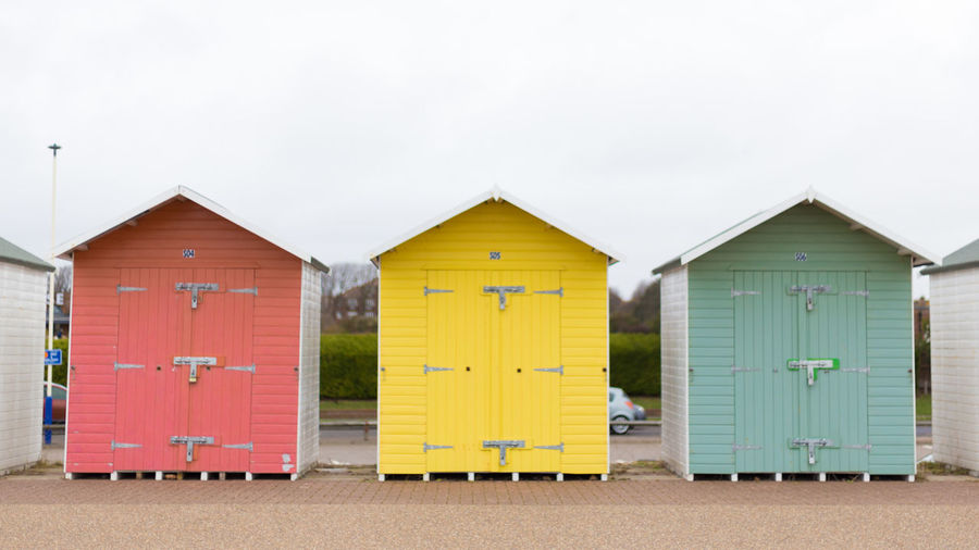 Architecture Built Structure Building Exterior Yellow Beach Hut Day Multi Colored Hut Nature Side By Side Sky No People Land Wood - Material Outdoors Building Beach In A Row Green Color Copy Space Cabin Eastbourne