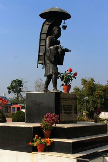Xuanzang Statue, Xuanzang Memorial, Nalanda Xuanzang Temple Xuanzang Plant Flower Human Representation Flowering Plant Growth Statue Architecture Potted Plant Nature Representation Sculpture Day Sky Art And Craft Bouquet Sunlight Clear Sky Flower Pot Male Likeness Creativity Outdoors No People